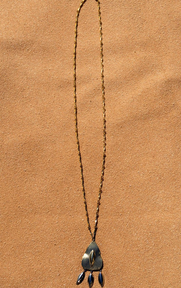 Vintage gold chain with a vintage earring as the pendant.