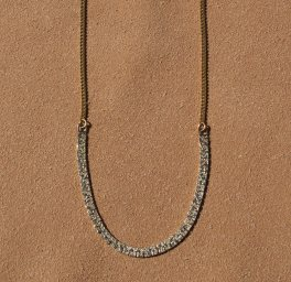 Vintage gold chain with a gold vintage bracelet as the centerpiece of the necklace.